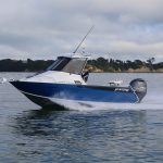 Surtees 610 Gamefisher on the water